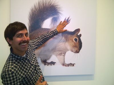 Movember giving a squirrel high five