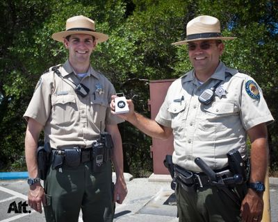 CA State Park Rangers on top of Tam shaking their Alt.